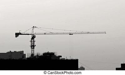 Enormous Construction Crane Lifting Concrete Bucket in Timelapse