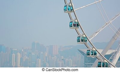 Enormous Ferris Wheel with a City Skyline in the Background...