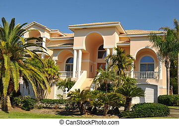 Beautiful, three story neo-mediterranean home with huge stairway leading to the entryway. Arches, low-pitch tiled roof, stucco and balconies lend strength to the spanish architecture with new american taste. Landscaping is tropical.
