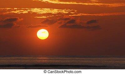 Enormous Orange Sun Setting over Phuket Tropical Beach -...