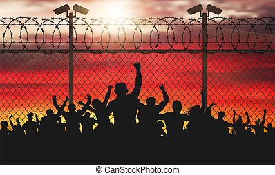 Enraged crowd of people are behind bars. Fence wire mesh barbed wire, vector silhouette. Street camera on the pillar. Sunset background. (Clipping Mask)