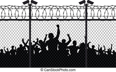 Enraged crowd of people are behind bars. Fence wire mesh ...