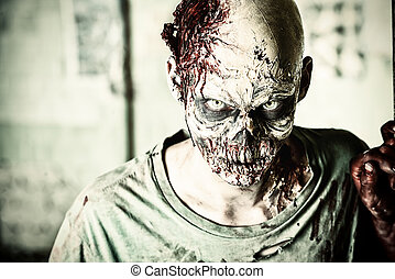 ensanguined - Horrible scary zombie man on the ruins of an...