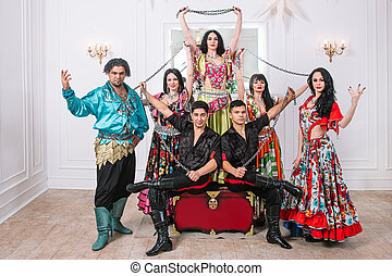 ensemble of folk Gypsy dance in traditional costumes
