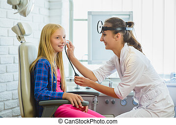 Ent doctor or Otolaryngologist examining a kid ear
