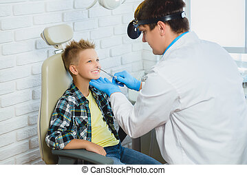 Ent doctor or Otolaryngologist examining a kid nose
