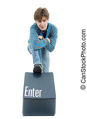 enter key - young casual man with the enter key