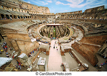 Enter to first circle of arena in ancient Coliseum in Rome, Italy at sunny day under cloudy blue sky