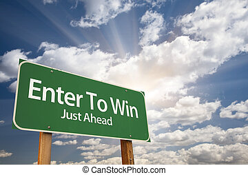 Enter To Win, Just Ahead Green Road Sign Over Dramatic Sky, Clouds and Sunburst.