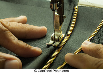 Enter zip. - Chang was hand sewing the zipper.