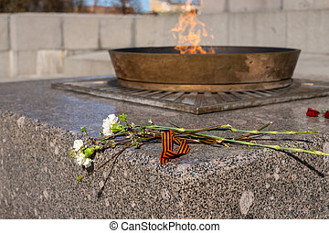 Enternal flame in russia. Symbols of memory and respect of the victory of Soviet soldiers in the Second World War and the Russian military in armed conflicts. Victory Day.