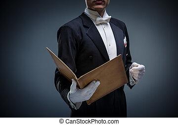 Man in a tuxedo with a folder