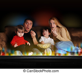 Entertainment Family Watching TV - A young family is...