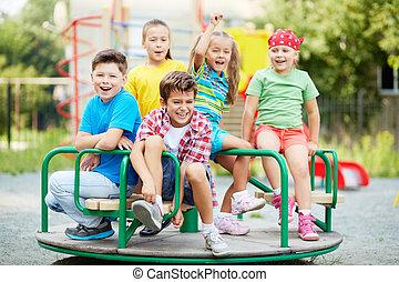 Entertainment for kids - Image of joyful friends having fun...