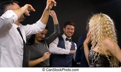 happy friends dancing at party or disco - entertainment,...
