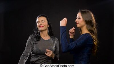 happy women dancing at party or disco - entertainment, night...