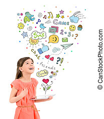 Entertainment with digital tablet - Happy cute little girl ...
