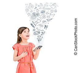 Happy cute little girl in red dress holding a smartphone in hand and fascinated looking up at the icons of different entertainment apps. Isolated on white background