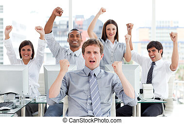 Enthusiastic business team celebrating success in the office
