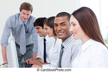 Enthusiastic business team working at computer