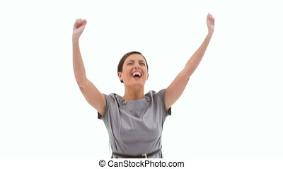 Enthusiastic businesswoman jumping against white background