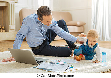 Enthusiastic child playing with the documents of his father
