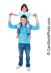 Enthusiastic father giving his son piggyback ride
