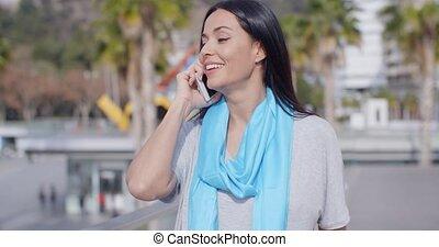 Enthusiastic female using phone outdoors - Enthusiastic...