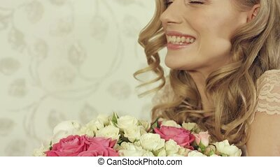 Enthusiastic girl posing with a big and beautiful bouquet of small roses