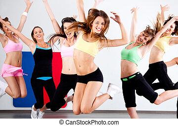 Enthusiastic group of women having fun during aerobics...