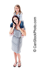 Enthusiastic mother giving her daughter piggyback ride
