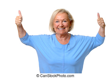 Enthusiastic motivated senior woman with a beaming smile...
