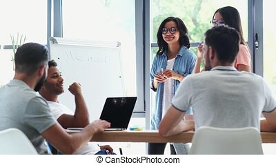 Enthusiastic positive colleagues working in the office -...