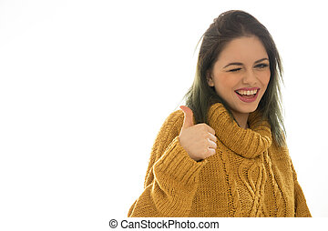 Enthusiastic woman winking and giving a thumbs up -...