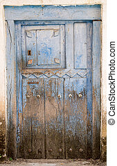 Entire old blue painted wooden door and lock