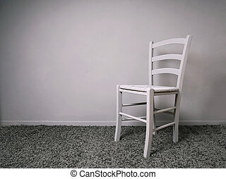 entirely gray room with empty chair and copy space