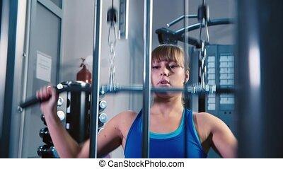 entraîneur, femme, athlétique, séduisant, fitness, confection, exercice