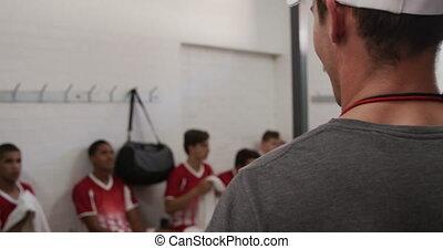 entraîneur, joueurs, rugby, salle, conversation, casier