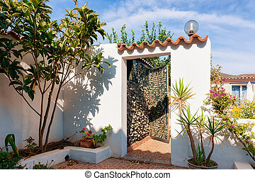 Entrance door in courtyard of house in Porto Cervo