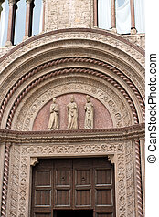 Entrance door to a historic palace in the center of Perugia