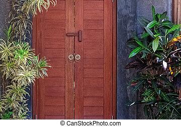 Entrance door to the villa with garden