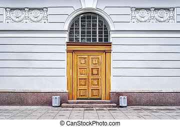 Entrance doors with an arch.