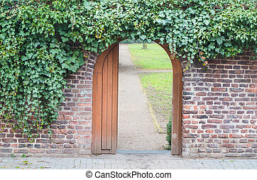Entrance gate in a wall