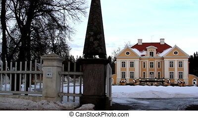 Entrance gate of a big old manor house in Estonia Baltic...