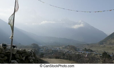 Entrance gate to nepalese village Sama Gaon among the ...