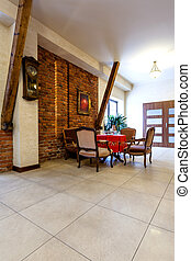 Entrance hall in hotel interior - Entrance hall with brick...