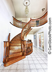 Entrance hall with staircase - Curved oak staircase in...