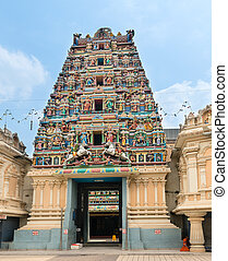Entrance in a temple with Hindu Gods on gopuram -...