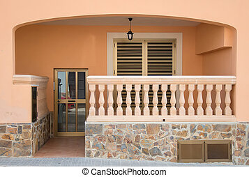 Entrance into the house with balcony.