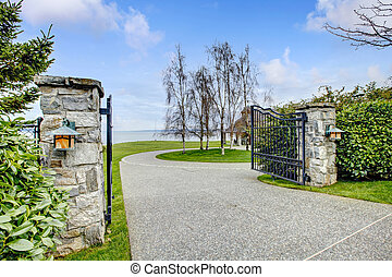 Entrance iron gates with stone columns